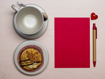 Empty cup cupcake and red blank paper Stock Photography