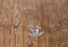 Empty cup with dish isolated on wooden texture Royalty Free Stock Photography
