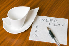 Empty cup with handwriting week plan on napkin 2 Royalty Free Stock Photos