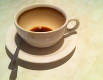 Empty coffee cup. Empty cup of coffee on marble table Royalty Free Stock Images