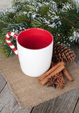 Empty cup for mulled wine, spices and fir tree Stock Photos