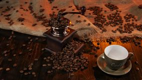 Empty cup with the name `coffee` on the wooden table stock video footage