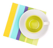 Empty cup on placemat. Empty cup on color placemat. Isolated on white background Stock Photography