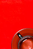Empty cup on a red background Royalty Free Stock Photo
