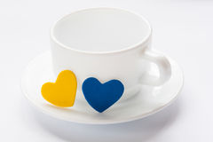 Empty cup and saucer with hearts Stock Photo