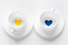 Empty cup and saucer with hearts Royalty Free Stock Photos
