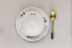 Empty cup on a saucer and spoon. Food Royalty Free Stock Photos