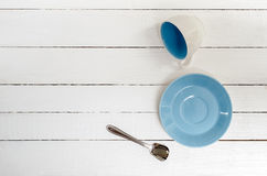 Empty Cup, saucer and spoon. On wooden background,top view Royalty Free Stock Photography