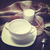 Empty cup of soup and a glass of milk on a wooden table. Toned i Royalty Free Stock Images