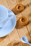 Empty cup with spoon and cookie on table Stock Photo