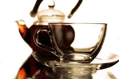 Empty cup and the teapot Stock Photos