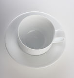 Empty cup on white background - studio shot Stock Photography