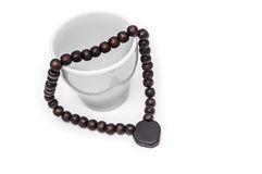 Empty cup with wooden beads for meditation Royalty Free Stock Photo