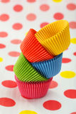 Empty cupcake cases on the colorful background Royalty Free Stock Photography