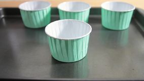 Empty cupcake cases on a tray stock video footage