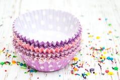 Empty cupcake cups Stock Photos
