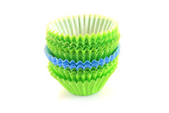 Empty cupcake cups in green and blue Royalty Free Stock Photos