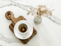 Empty cups of coffee with dry flowers Royalty Free Stock Image