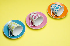 Empty cups on colorful saucers Royalty Free Stock Photos