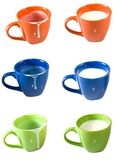 Empty cups and cups of milk Royalty Free Stock Image