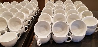Empty cups stacked in rows on the table stock photography