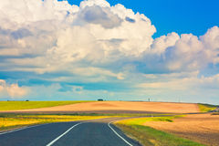Empty curved road, blue sky Royalty Free Stock Photos