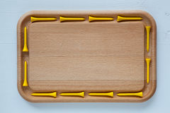 Empty cutting board with different golf tees Stock Photography