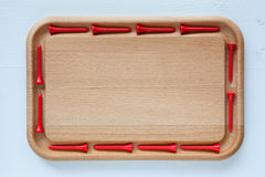 Empty cutting board with different golf tees Royalty Free Stock Images