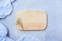 Cutting board on rustic background stock photo