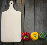 Empty cutting board and paprika Royalty Free Stock Photography