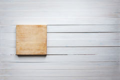 Empty cutting board on vintage white wooden board food background concept royalty free illustration