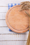 Empty cutting board on white table.  Place for your text. Stock Photos