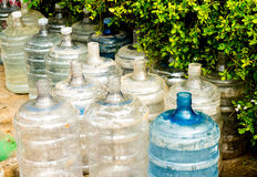 Empty damaged plastic water bottles. Many indians do not have access to clean drinking water an must rely on locally bottled water for consumption Royalty Free Stock Images