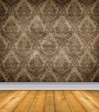 Empty Damask Room With Bare Floors. Empty room with shabby damask wallpaper and bare wood floor Stock Photo
