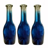 Empty dark blue bottles. Isolated on a white background Stock Images