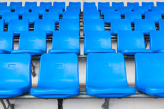 Empty dark blue chairs at the football Stadium Stock Photography