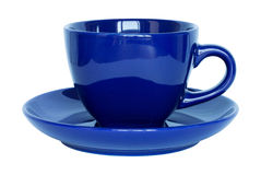 Empty dark blue cup and saucer isolated on white Royalty Free Stock Images