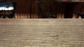 Empty dark brown wooden table for product placement in restaurant Stock Photo