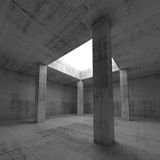 Empty dark concrete room interior with columns. Abstract architecture background, empty dark concrete room interior with white square opening in ceiling and Stock Photography