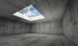 Empty dark concrete room interior with window in ceiling Royalty Free Stock Image