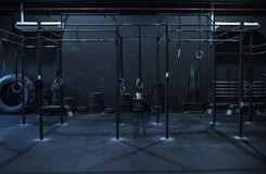 Cross fit zone training. Empty dark cross fit room at gym with ambient light Royalty Free Stock Photos