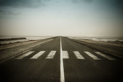 Empty dark road near the CHOTT EL JERID Royalty Free Stock Photography