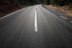 Empty dark rural asphalt highway perspective Stock Photos