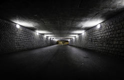 Empty dark tunnel at night. With lights stock photo