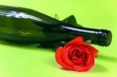 Empty dark wine bottle with red rose Royalty Free Stock Photo
