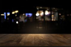 Empty of dark wooden table in front of abstract blurred background of bokeh light . can be used for display or montage your stock photo