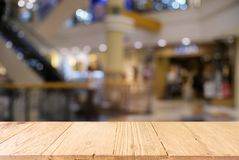 Empty dark wooden table in front of abstract blurred background Royalty Free Stock Images
