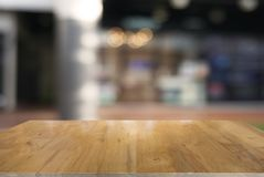 Empty dark wooden table in front of abstract blurred background Stock Photo