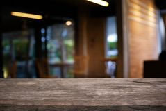 Empty dark wooden table in front of abstract blurred bokeh backg Royalty Free Stock Image