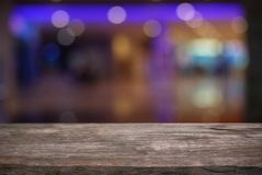 Empty dark wooden table in front of abstract blurred bokeh background of restaurant . can be used for display or montage your pro stock images